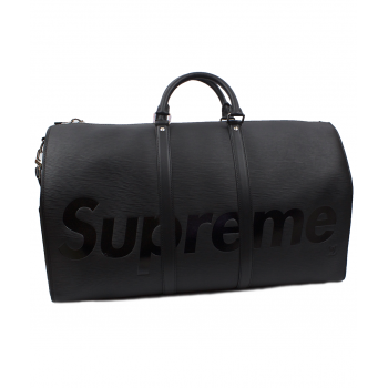 Louis Vuitton x Supreme...